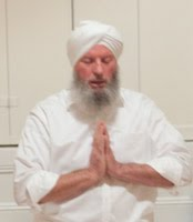 Nam Sangat Singh tuning in before teaching a Kundalini Yoga class